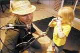JUSTIN FOX BURKS - Cory Branan sings and a youngster plays harmonica at the Memphis Rock-n-Romp