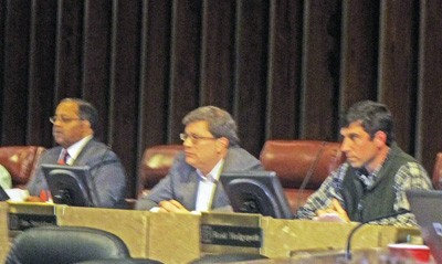 Council chairman Myron Lowery, Jim Strickland, and Reid Hedgepeth listen to a speaker from the audience.