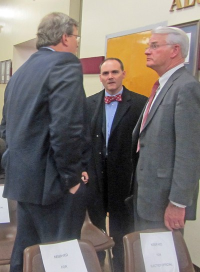 Councilman Jim Strickland, County Commissiner Mike Carpenter, and County Mayor Mark Luttrell huddle before the summit.