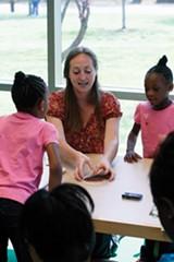 JUSTIN FOX BURKS - Courtney Eskew tutors students on Saturdays.