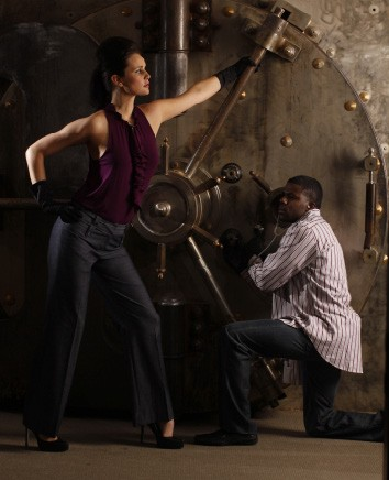 "Cracking the Code On her: Theory black-cherry sleeveless top with Parameter ""Amy"" pants, both from Lola. On him: Thomas Dean striped button-down, from Lansky 126, with Sacred Blue jeans, from Lux. - JUSTIN FOX BURKS"