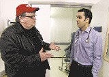 Cure-all? Michael Moore (left) in Sicko