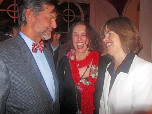 District Attorney General Amy Weirich (right) and hostess Pat Kerr Tigrett respond to jest by guest Rick Masson at Weirich fundraiser this week.