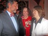 District Attorney General Amy Weirich (right) and hotess Pat Kerr Tigrett respond to jest by guest Rick Masson at Weirich fundraiser this week.