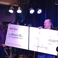 Hard Rock's New Digs Dodds presents a ginormous check to John Doyle, the executive director of the Memphis Music Hall of Fame. Joe Boone