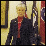Doing the right thing? Rosalind Kurita, flanked by flags in her office. - JACKSON BAKER