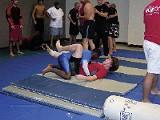 Down to the mat: Brian Hall of Team Vortex pins fellow team member Ryan Sample.