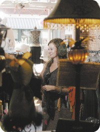 Downtown resident Carrie O'Guin shops at Muse on South Main. - JUSTIN FOX BURKS