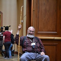 "MidSouthCon 32 Dwayne LaFrain stands guard at the dealer room, calling himself the ""Grumpy Old Man."" Lisa Elaine Babb"