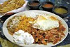 El Palmar's <i>huevos con chilquilas,</i> fried eggs with a side of rice and beans