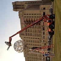 "Eli Gold and Colin Kidder install their ""Beacon"" sculpture."