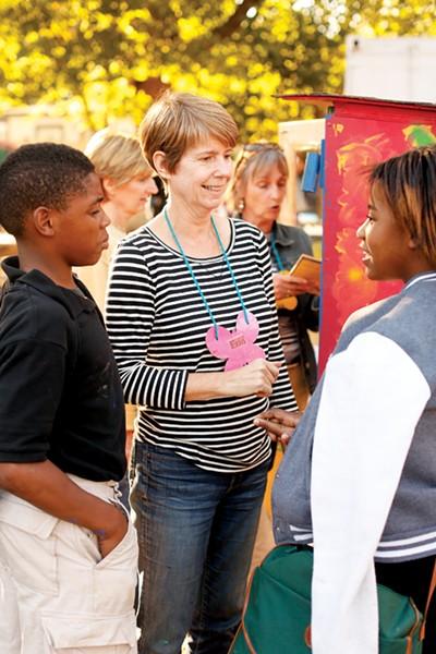 Erin Harris with kids at the Carpenter Art Garden in Binghampton - JUSTIN FOX BURKS