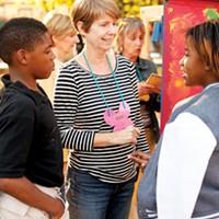 Erin Harris with kids at the Carpenter Art Garden in Binghampton