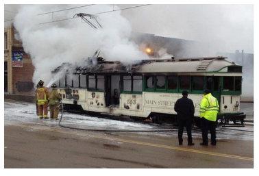 Firefighters extinguish trolley No. 553 in June.