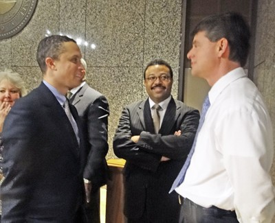Former congressman Harold Ford Jr., county administrative assistant Clay Perry, and Probate clerk Tom Leatherwood chatted after the event. - JB
