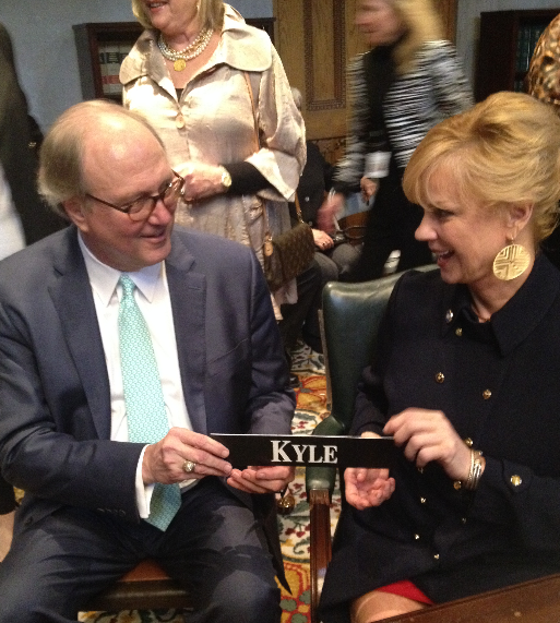 Former state Senator -- now Chancellor --Jim Kyle turns over his old nameplate to wife Sara Kyle, who was elected to succeed him in the Senate.