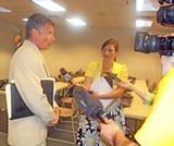 Giannini explains things to the media. - J.B.