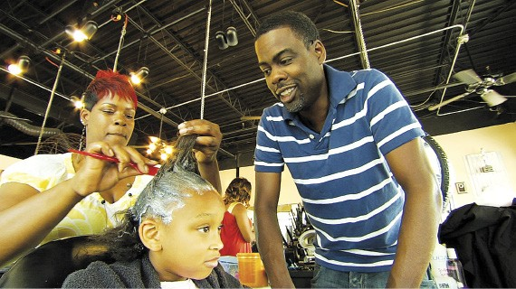 """""""Good hair"""" in the making: Chris Rock watches."""