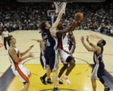 AP PHOTO/MARCIO JOSE SANCHEZ - Griz/Warriors action late in the game.