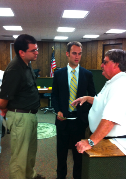 Guerrero (left) discusses the case with his attorney DeBoard (center) and code enforcement officer Byron Jamison (right)