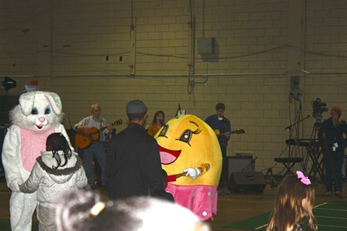 In the Plipkin Building, children dance with Easter-themed characters while local band the Mason Jar Fireflies performs.