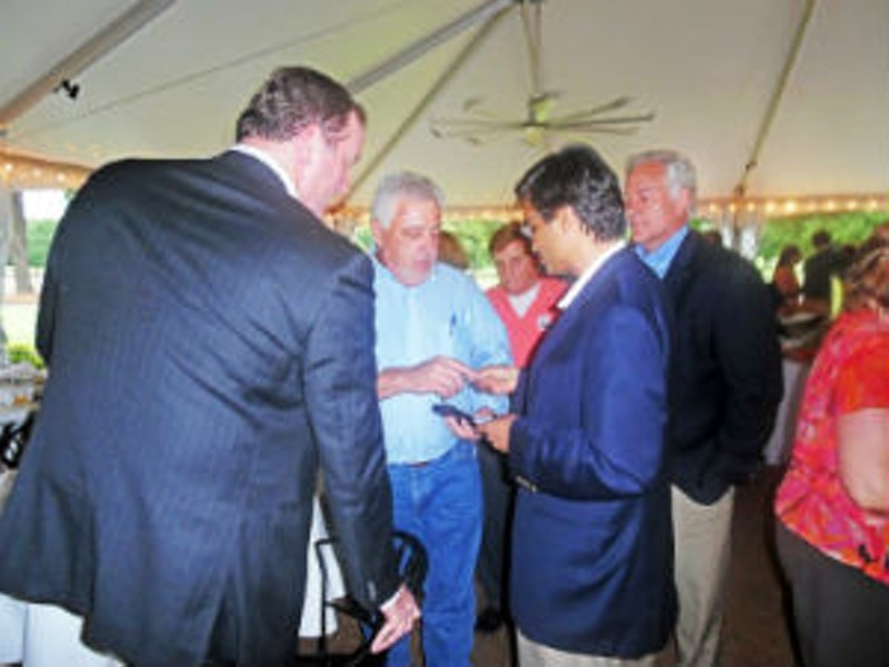 Jain interacts with County Trustee David Lenoir and County Commissioner Terry Roland, while his bemused election opponent Steve Basar looks on. - JB