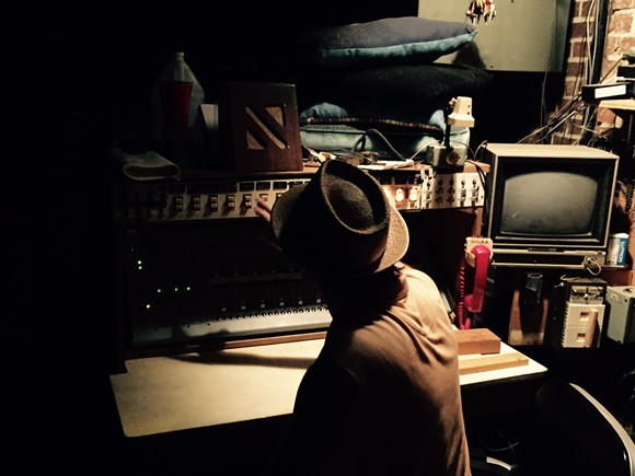 Jason Miller, behind the board. Backstage at the Scottish Rite Temple - CHRIS DAVIS
