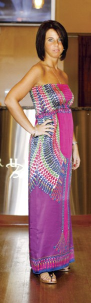 """Jessica Robinson's colorful, Egyptian-inspired maxi dress is certainly eye-catching. - Though it can be worn with straps or without, Robinson says, """"I like it better strapless, because I like to show off my shoulders."""" - JUSTIN FOX BURKS"""