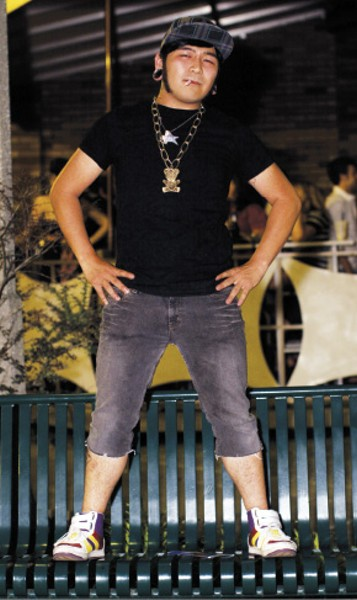 """Jim Duong loves his Creative Recreation shoes and his teddy bear """"bling,"""" but we were interested in the denim capris he picked up from Mid-South Veterans. - """"These jeans are girls',"""" he says, """"but I cut them off myself. They're tighter than I thought they'd be, but they're stretch jeans, so it's okay. Guys' jeans don't stretch at all."""" - JUSTIN FOX BURKS"""