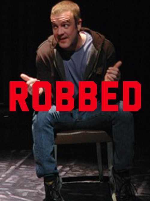 John Moore played a cop... And got robbed.