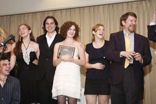 John Rone (RIGHT) accepts an Ostrander Award with the cast of Pride & Prejudice