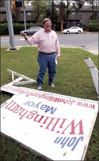 John Willingham checks on vandalized campaign signs on the corner of Colonial and Park. - JUSTIN FOX BURKS