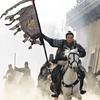 John Woo heads home, in triumph.