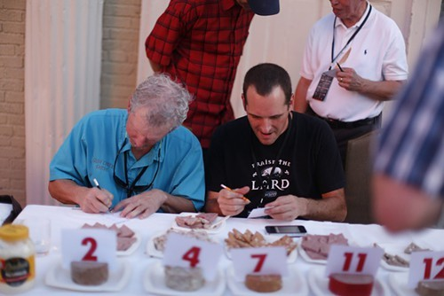 Judges scoring the bologna.