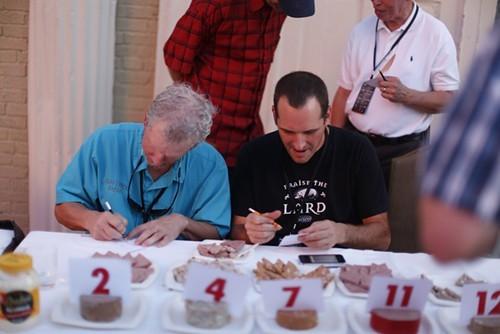 Judges scoring the bologna.