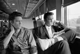 "PHOTOGRAPHS © ALFRED WERTHEIMER. ALL RIGHTS RESERVED. - ""Junior Smith and Elvis Presley"": Elvis with his cousin Gene Smith on the 27-hour train ride from New York to Memphis, July 4, 1956."