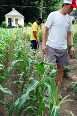 Knowledge Quest founder Marlon Foster and Christian Man at Green Leaf Farm.
