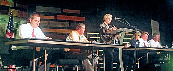 Lakeland mayor candidates Wyatt Bunker and Scott Carmichael dueled at a forum held last week on the eve of city elections.