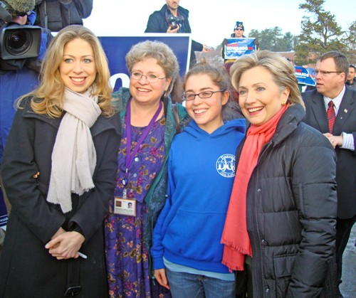Looking confident at a Nashua poll Tuesday morning were Hillary Clinton (r) and daughter Chelsea (l), here with two New Hampshire voters. - JB
