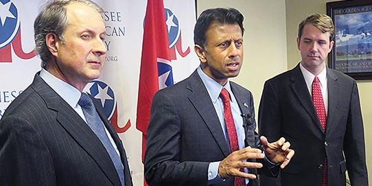 Louisiana Governor Bobby Jindal, flanked by state GOP Chairman Chris Devaney (l) and Shelby County Democratic Chairman Justin Joy.