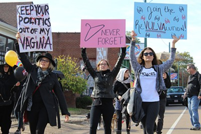 Marchers in the second line displayed signs. - ALEXANDRA PUSATERI
