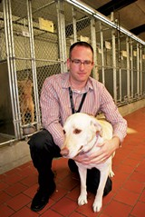 Matthew Pepper holds a personal current favorite among the shelter's adoptable dogs.