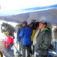 Snapshots from the Klan Rally Members of the press pack at the Klan rally, huddled and trying to stay warm and dry. JB