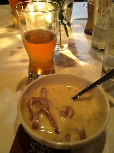Beer cheese soup with brandy duck sausage served with their Famous Flaming Stone beer