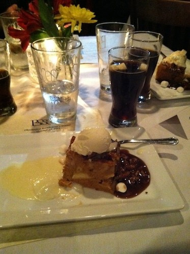 Pumpkin bread pudding with a praline and marshmallow cream sauce, served with a marshmallow-topped Milk Stout
