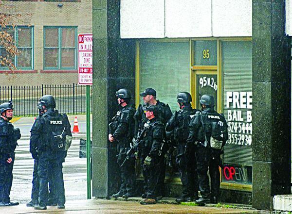Memphis Police don body armor for last year's KKK rally. - JACKSON BAKER