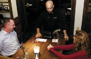 """Mesquite Chop House manager Josh Cobbs """"bails out"""" one lucky couple. - BY JUSTIN FOX BURKS"""