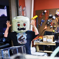 Making It In Memphis Midsouth Makers member Danny Chamberlin shows off the Lego head he made. Justin Fox Burks