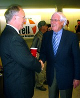 Mike Ritz (l), candidate in 1, 1, is greeted by veteran operative Bobby Lanier.
