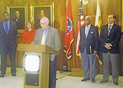 MLGW president Jerry Collins announces decision Monday as Mayor Wharton, officials, and legal aides look on. - JB